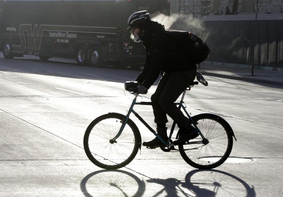 The breath of a bicyclist turns to steam and his beard frosts over as he bikes down the Nicollet Mall Tuesday, Jan. 22, 2013 in downtown Minneapolis where temperatures were in the double-digit, sub-zero numbers.