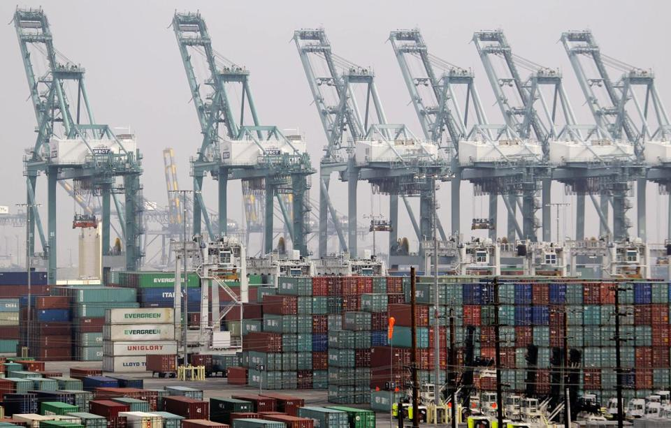 The government at first estimated the economy shrank in the last quarter of the year. Above, the Port of Los Angeles.