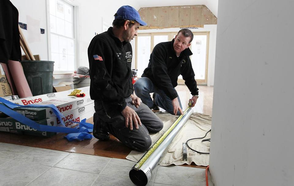 Contractor Padraig O'Beirne (right) did renovations on a home in Lunenburg.