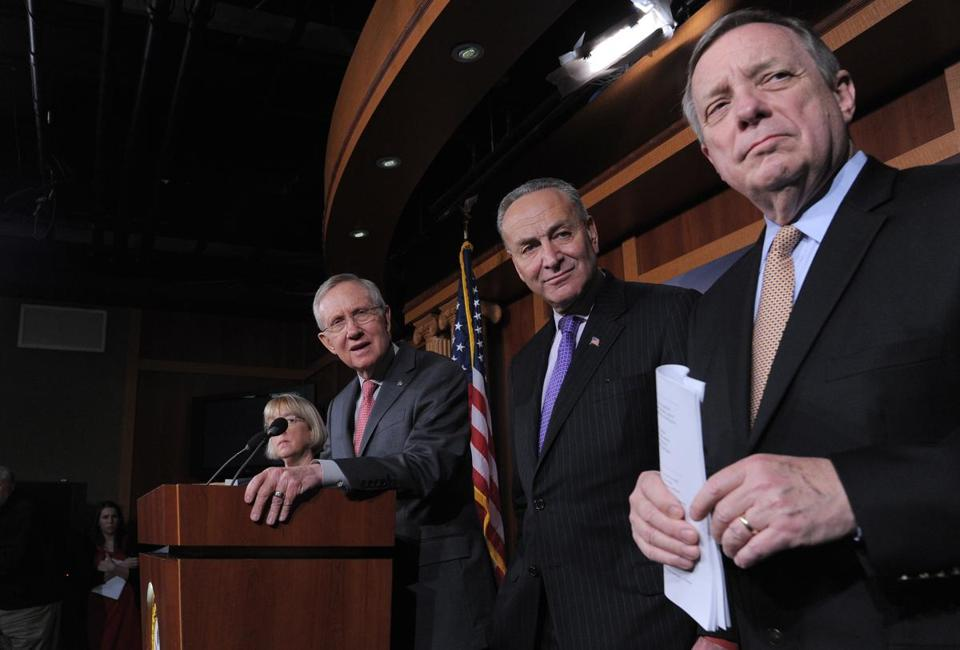 Senate Majority Leader Harry Reid Nevada (at the podium) held a news conference on the eve of the sequester with fellow Democrats Charles Schumer of New York (center) and Senate Majority Whip Richard Durbin of Illinois.
