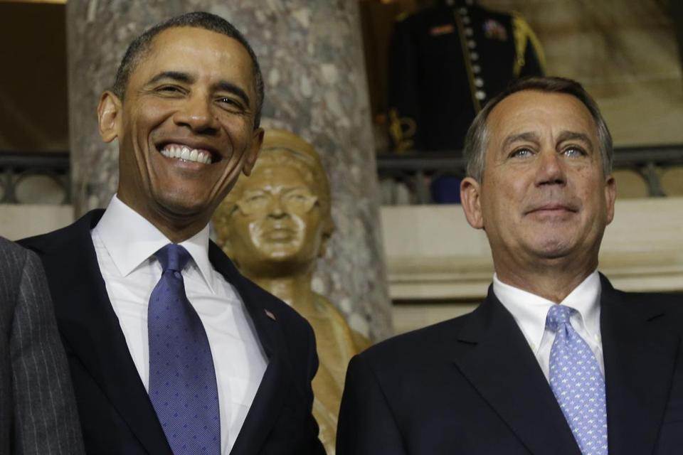President Obama and House Speaker John Boehner stood in front of a statue of Rosa Parks at the US Capitol.