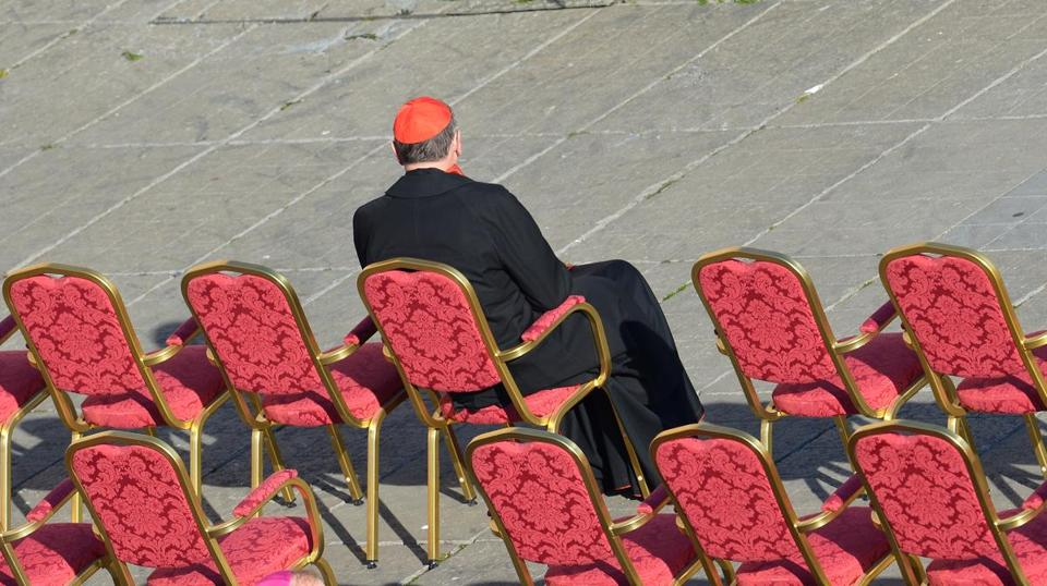 Retired Los Angeles Cardinal Roger Mahony took a seat on St. Peter's Square ahead of Pope Benedict XVI's last weekly audience on Feb. 27 at the Vatican.