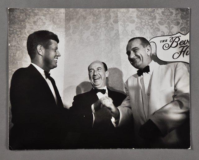 A photograph of the president with Lyndon Johnson and Adlai Stevenson, taken in November 1963 shortly before Kennedy's death, was auctioned off for $700.
