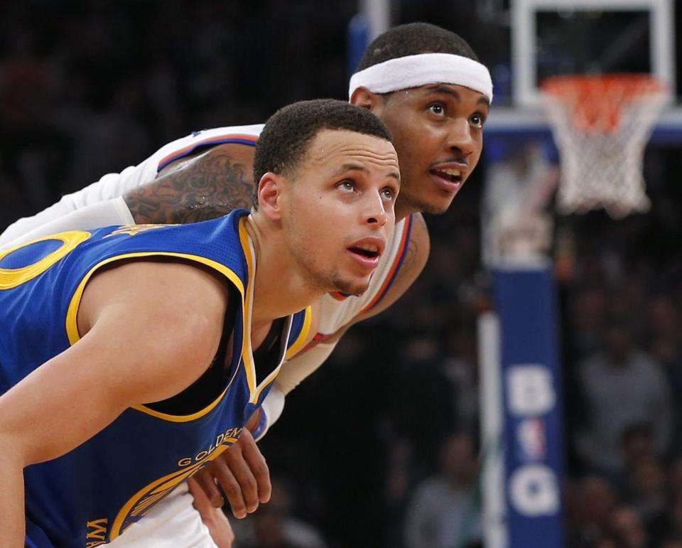 Stephen Curry, left, scored 54 points against Carmelo Anthony and the Knicks on Wednesday.