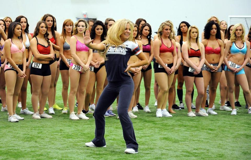 Veteran New England Patriots cheerleader Stephanie Sanchez demonstrates a routine for the women at Gillette Stadium Saturday to try out for the squad.