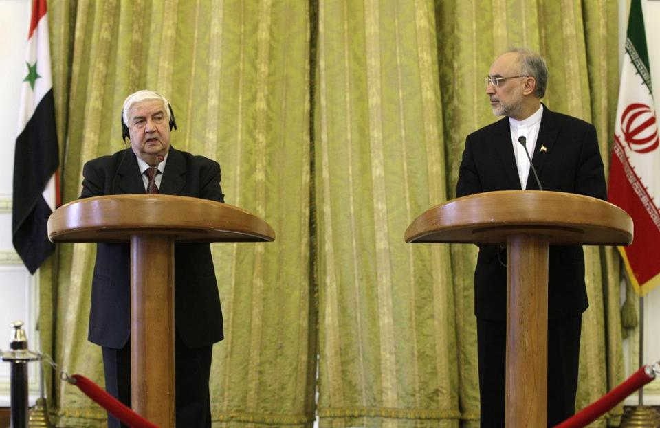 Foreign Minister Walid al-Moallem of Syria and his Iranian counterpart, Ali Akbar Salehi, spoke in Tehran. Salehi said President Bashar Assad may run for another term in 2014.