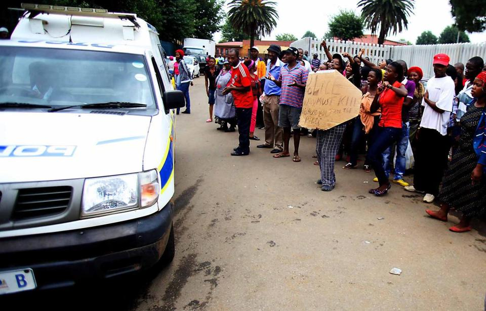 Residents of Daveyton, South Africa, protested Friday outside a police station over the death of a taxi driver.
