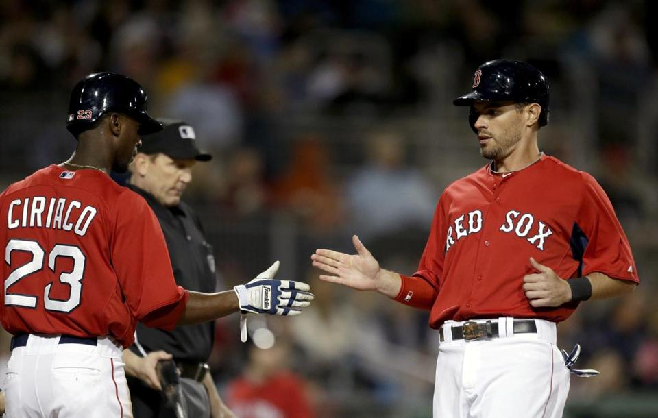 Justin Henry (right) high-fived Pedro Ciriaco after the two scored off a single by Dustin Pedroia in the fifth inning of an exhibition spring training baseball game against the Pirates.