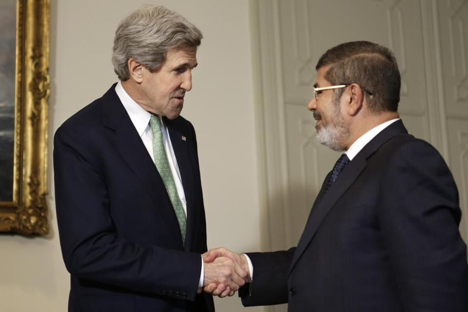 Secretary of State John Kerry shook hands with Egyptian President Mohamed Morsi at the Presidential Palace in Cairo, Egypt, wrapping up Kerry's visit to the deeply divided country with an appeal for unity and reform.