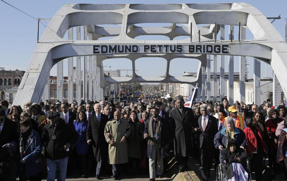 "Vice President Joe Biden and US Representative John Lewis led a group across the Pettus Bridge in Selma, Ala., to mark the 48th anniversary of the ""Bloody Sunday"" march"