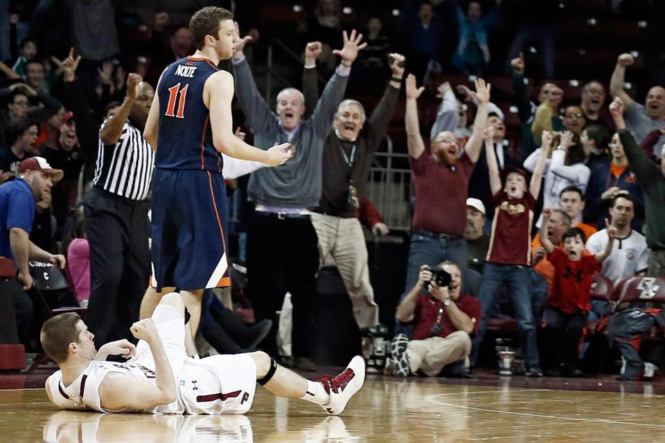 The crowd erupts and BC's Joe Rahon pumps his fist from the ground after hitting the winning 3-point basket.