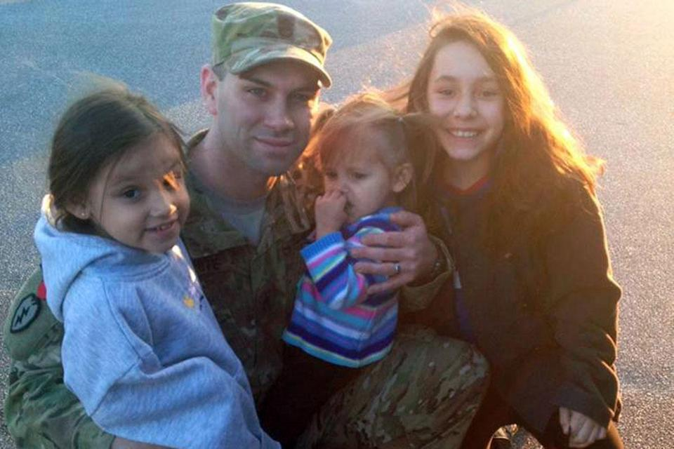 Army Staff Sergeant Greg Pizzute, with daughters Kayleigh, 4; Bella, 2; and Noelle, 11.