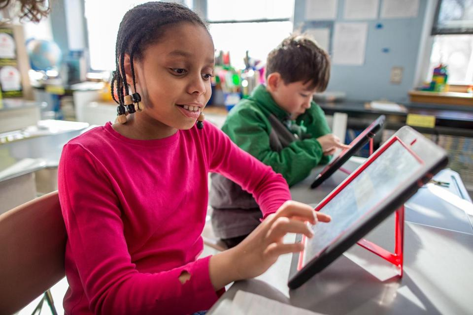 Tucker School third-graders Cheyenne Straughter and Peter Rhee used math applications on iPads.