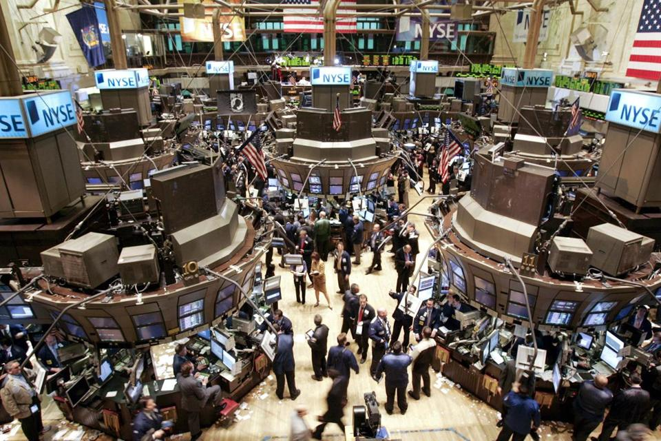 A general view of the main trading floor of the New York Stock Exchange during the closing moments of the trading session in New York February 27, 2007. The Dow Jones Industrial Average soared to a record closing high on March 5, 2013, breaking through levels last seen in 2007.