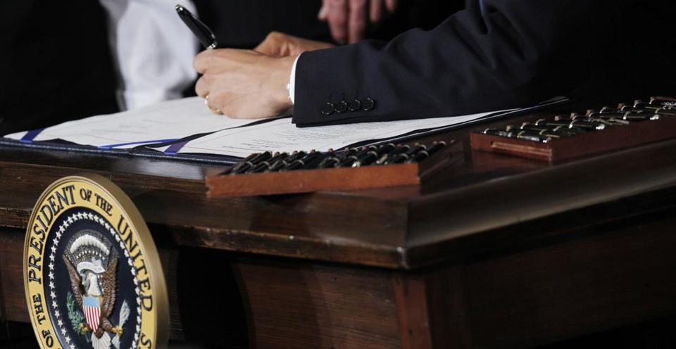 President Obama signed the health care reform bill into law in March 2010.