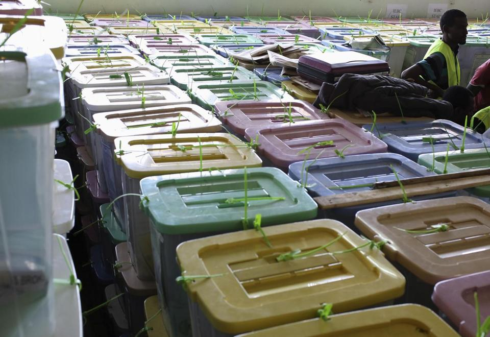 Election officials in Kenya looked over ballot boxes at the tallying center in Nairobi.