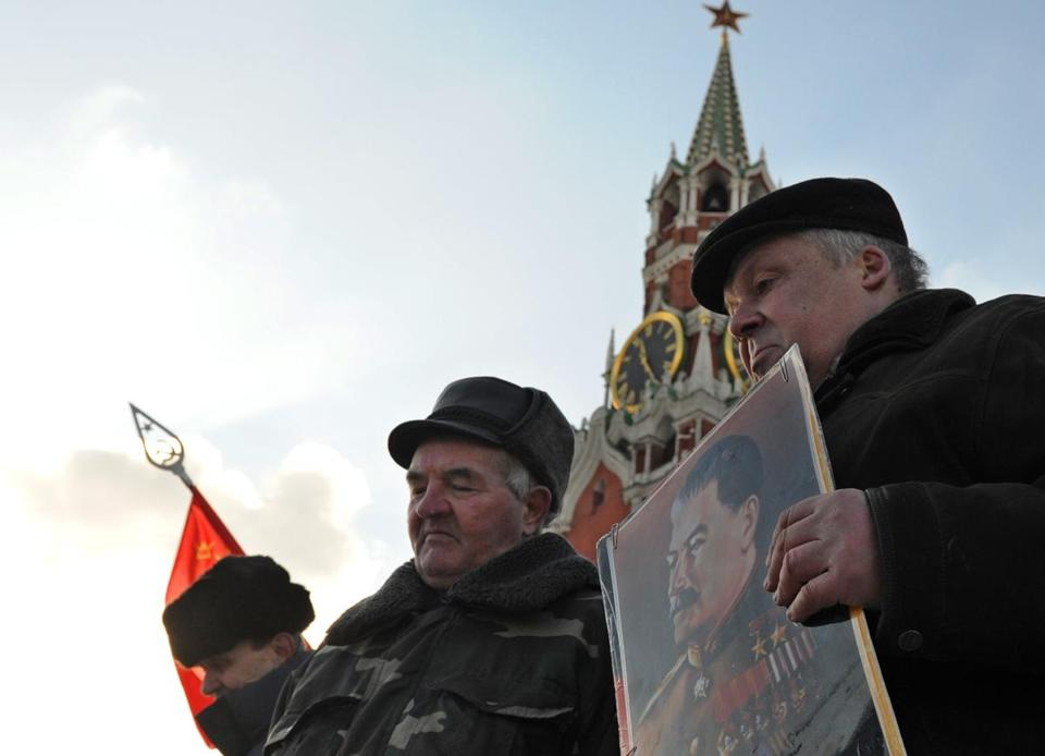 Russian Communists carried pictures of Josef Stalin as they laid flowers at his tomb on the 60th anniversary of his death.