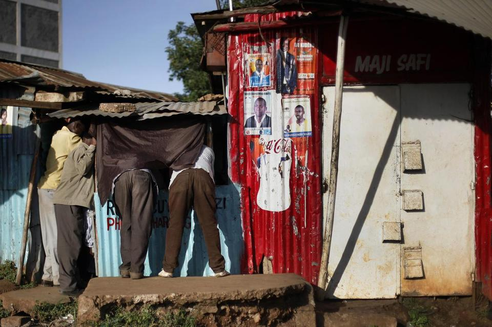 Kenyans watched television for news of the election results in a slum in Nairobi. Partial results showed that once again, voters chose overwhelmingly along ethnic lines.