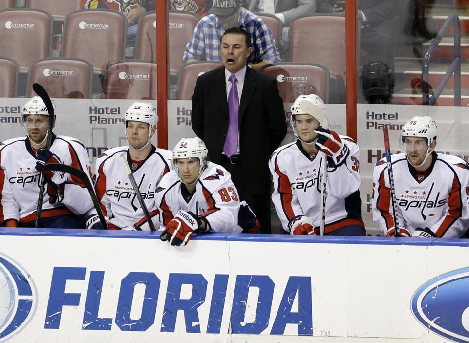 Adam Oates, rear, has gone from a Bruins standout player to the coach of the Capitals.