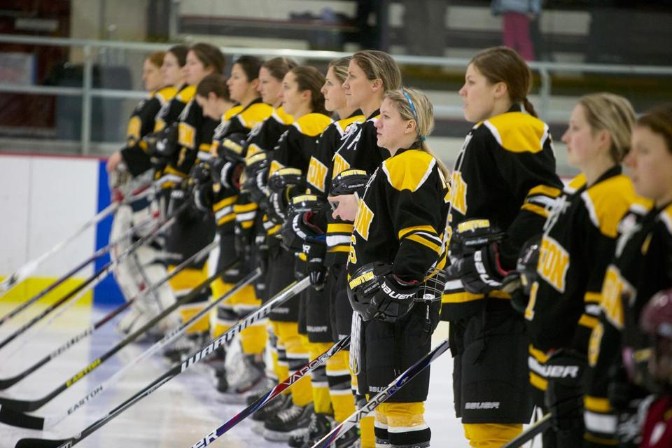 The Boston Blades, of the Canadian Women's Hockey League, stand for the national anthem before a February game at their home venue, Veterans Memorial Rink in Somerville.