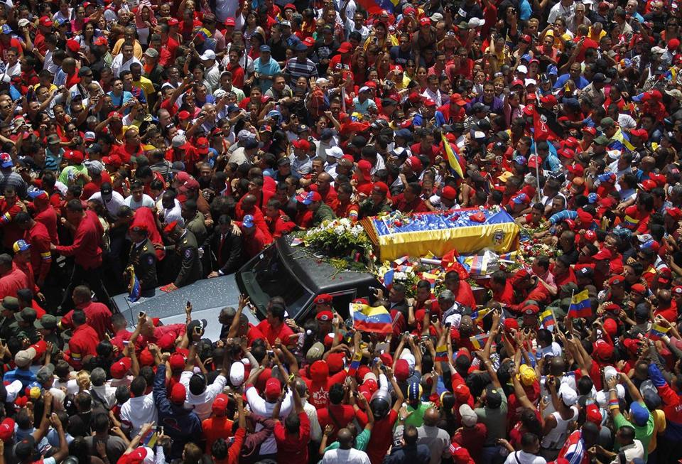 The coffin of Hugo Chavez was driven through the streets of Caracas on Wednesday after leaving a military hospital.