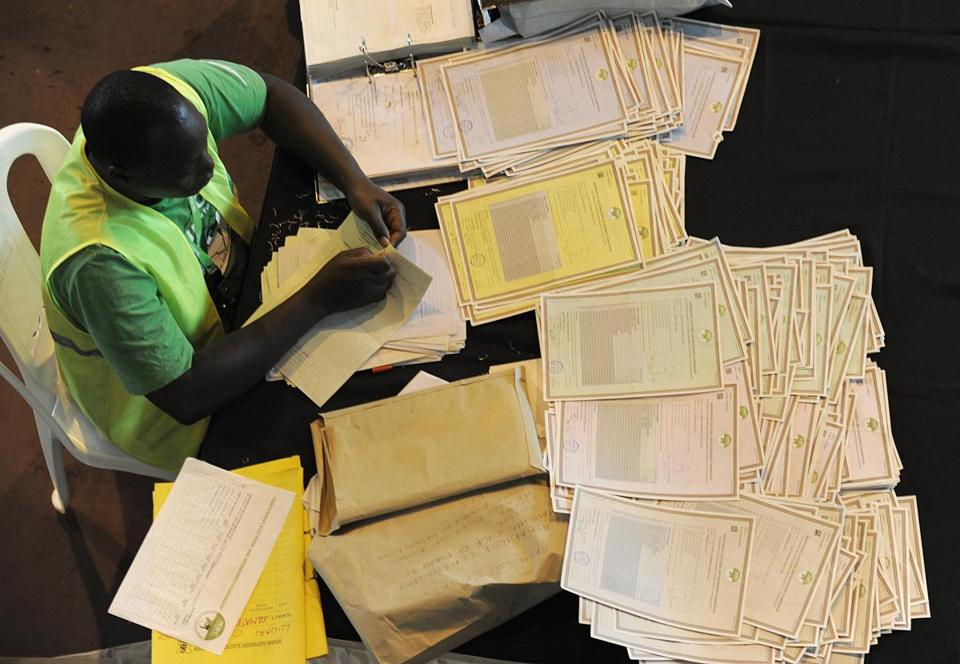 An officer of the Independent Electoral and Boundaries Commission viewed documents.