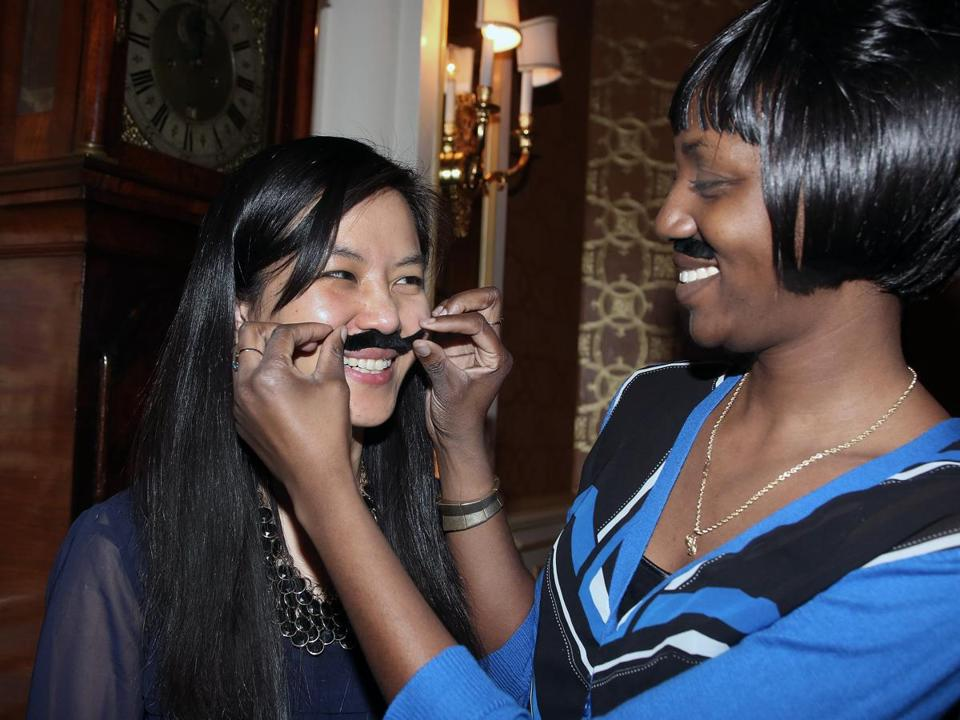 STICK UP: Ana Leon of Boston and Keron Cruz of Chelsea at the Mustachio Bashio, held at the Lenox Hotel in Boston and benefiting Community Servings on March 2