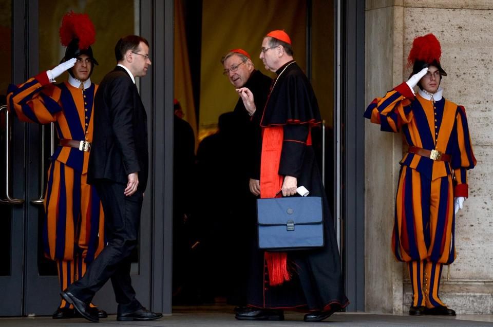 US cardinals Raymond Leo Burke (center) and Roger Michael Mahony (second from from) arrived for an afternoon pre-conclave meeting at the Vatican on Friday.