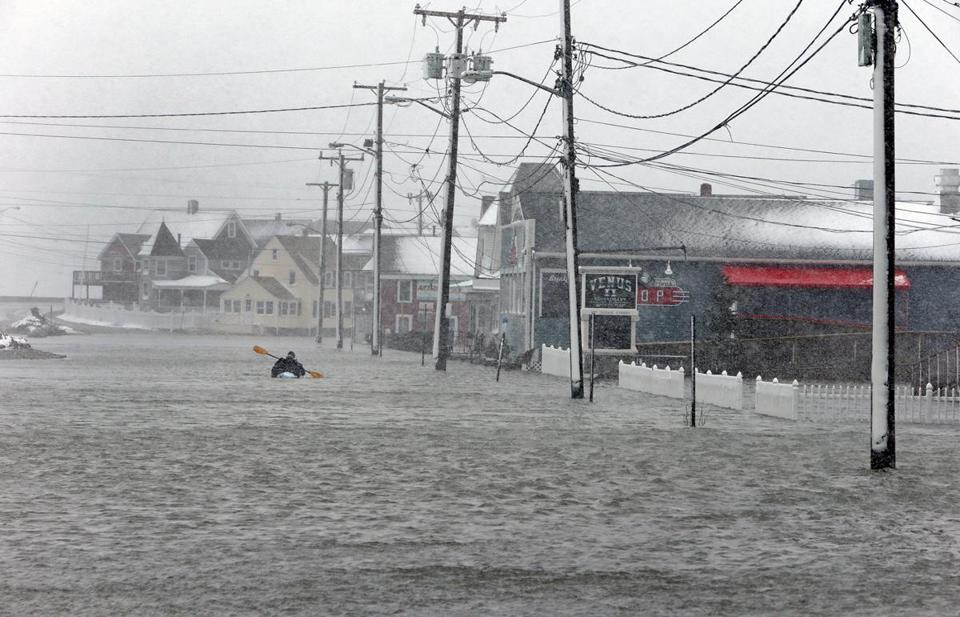 A kayak was paddled down the flooded esplanade area of Brant Rock in Marshfield this past March.