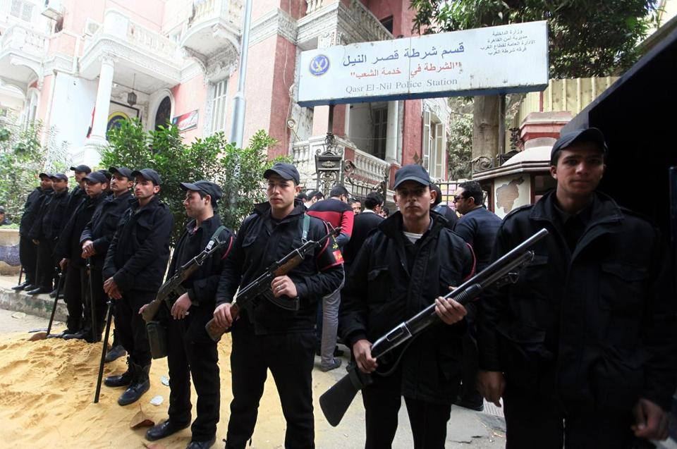 Egyptian police officers guarded a police station during a strike by colleagues in Cairo against government policies.