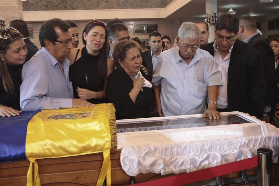Hugo Chavez's brother Adan, mother, Elena Frias, and father, Hugo, viewed his body in Caracas Thursday.