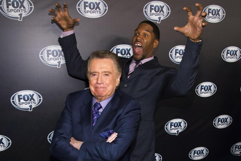 Television personality Regis Philbin, left, and Michael Strahan attend the Fox Sports Media Upfront party celebrating the new Fox Sports 1 network on Tuesday.