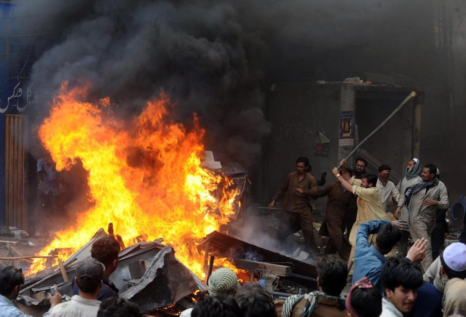 A Pakistani mob set fire to Christians' belongings in Lahore after a report of a derogatory remark on Islam's prophet.