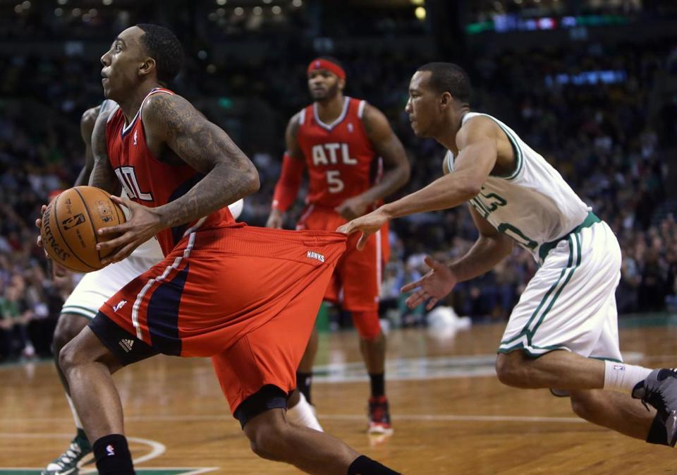 Though he has an outstanding defensive reputation, Avery Bradley stretched the rules while trying to slow down Hawks guard Jeff Teague.
