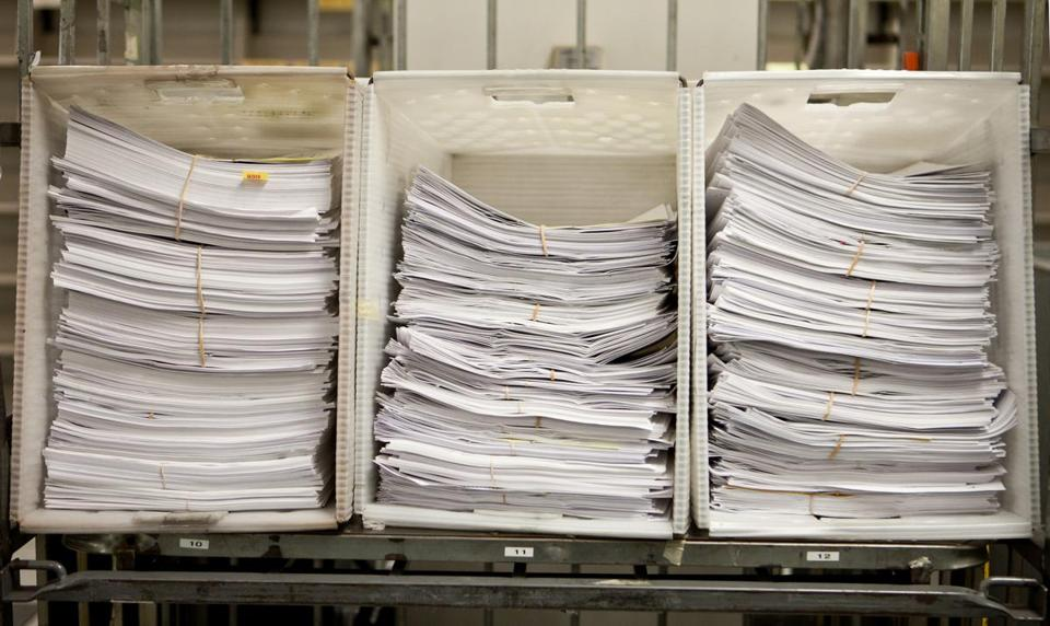 Paper tax returns for 2012 are piling up in the Data Integration Bureau of the Department of Revenue in Chelsea.