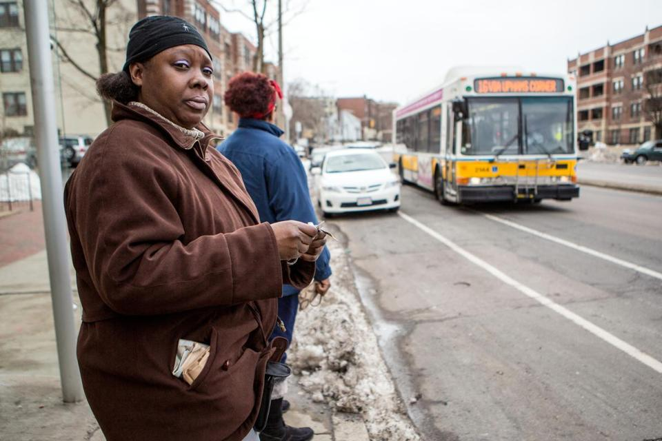 Cheryl Jones of Dorchester waited for a bus on Columbia Road on Monday, near the site of a weekend attack on an MBTA driver.