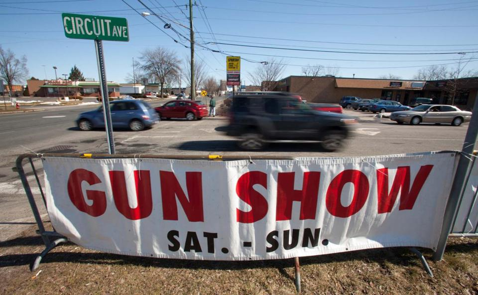 A sign to direct traffic was posted outside The West Springfield Gun and Knife Show in 2013.