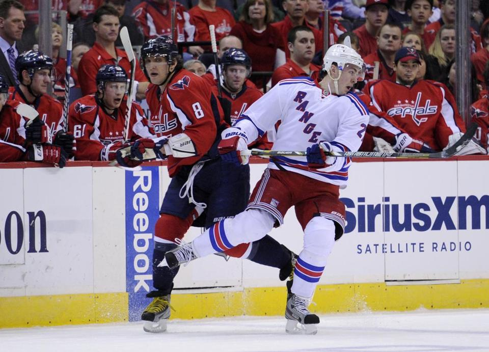 Alex Ovechkin gets tangled up with the Rangers' Ryan McDonagh in the first.