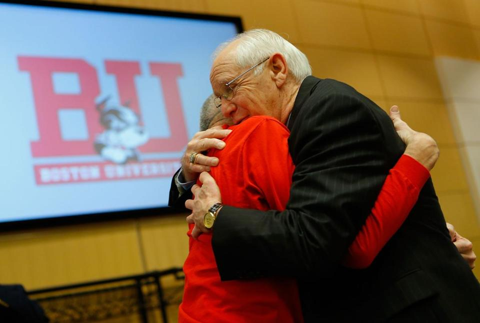 Jack Parker hugged longtime Boston University sports devotee Elliot Driben after announcing his retirement.