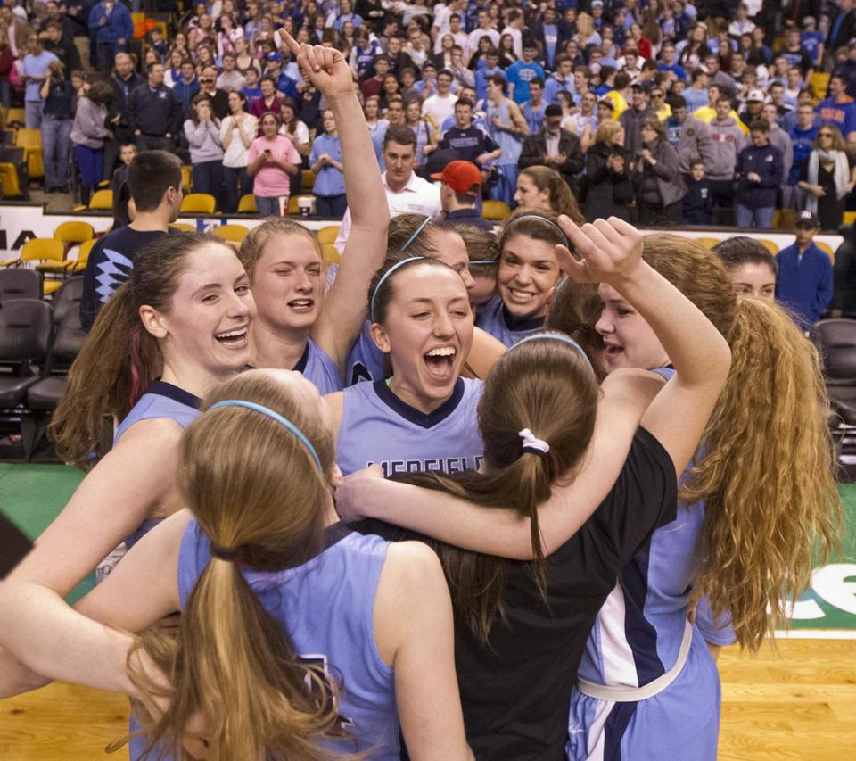 Medfield celebrates its overtime victory for the Division 2 girls' EMass title at TD Garden.