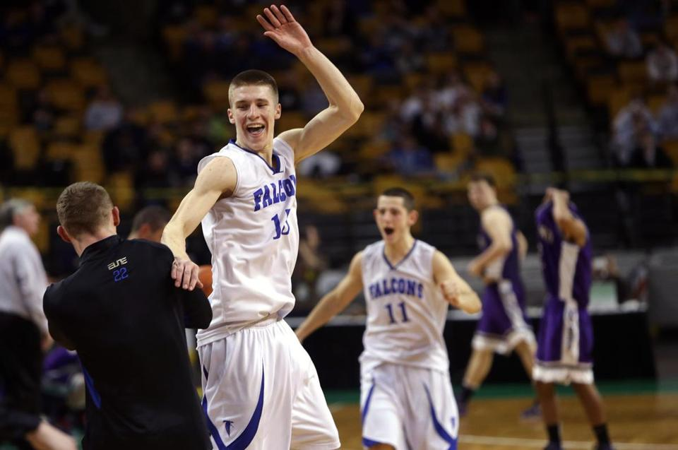 Nicholas Bates (15) and Eric Martin (11) celebrate as Danvers advanced to its second straight state final.