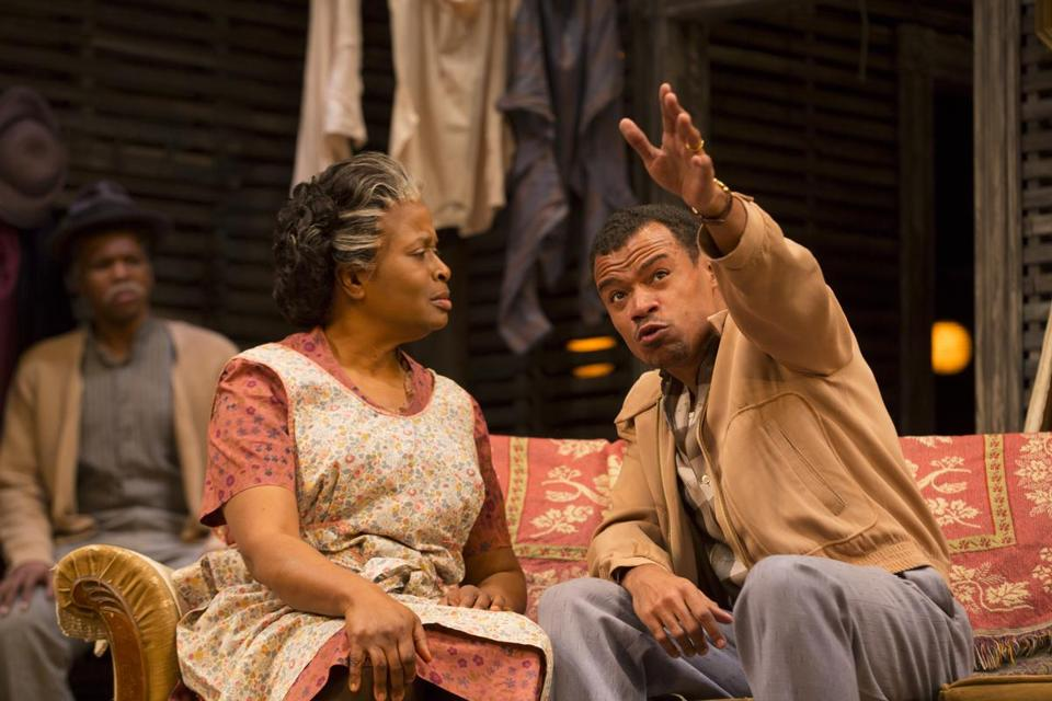 "Kimberly Scott as Lena Younger and LeRoy McClain as Walter Lee Younger in the Huntington Theatre Company's production of ""A Raisin in the Sun.''"