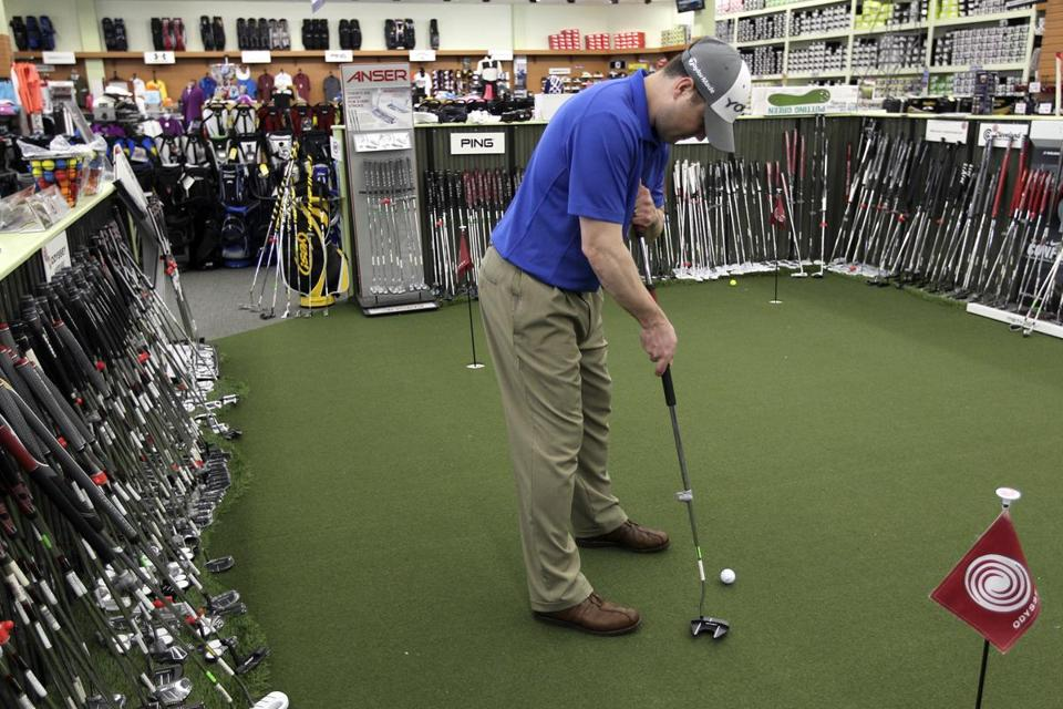 "Golf pro Russ Lipinski demonstrated how the long putter is ""anchored"" to the body."