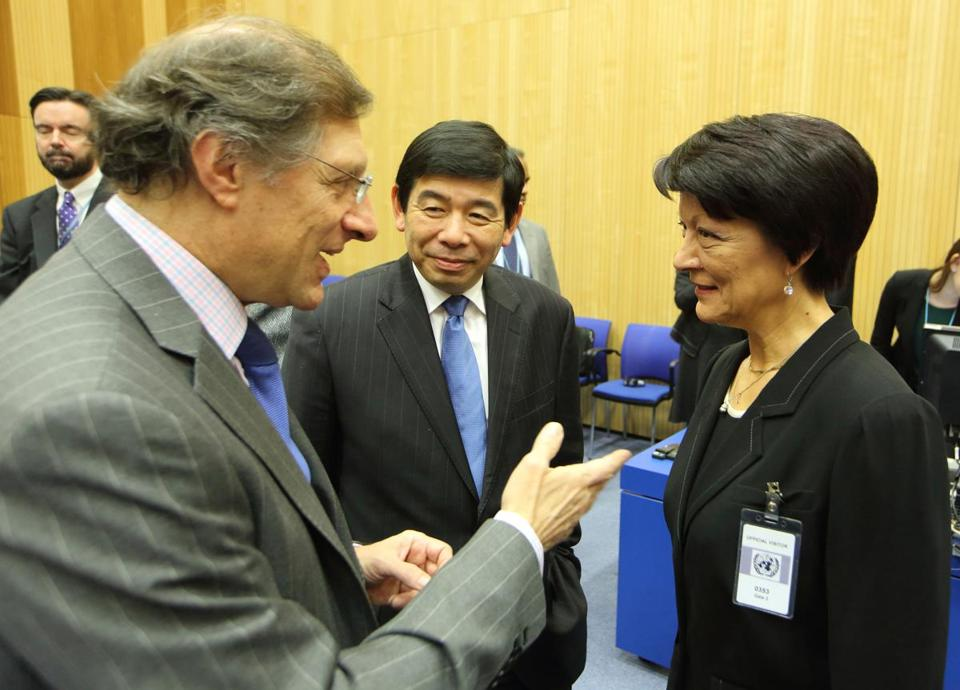Interpol president Mireille Ballestrazzi (right) chatted with Argentine Ambassador Eugenio Maria Curia (left) and World Customs Organization head Kunio Mikuriya.