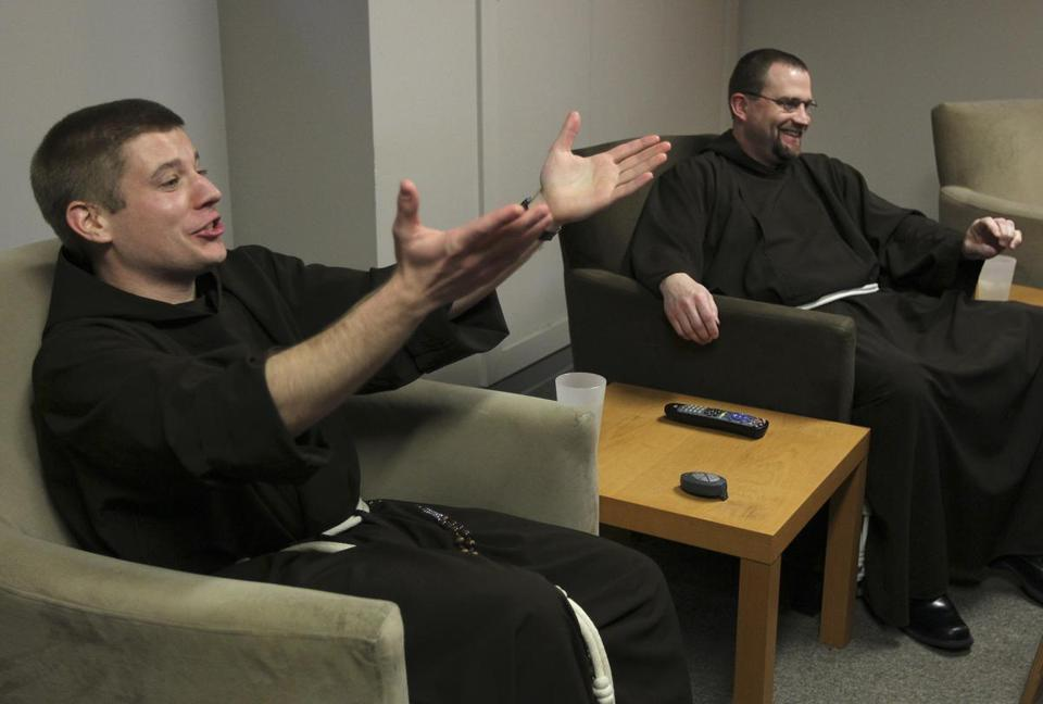 Brothers Matt Janeczko (left) and Jim Peterson reacted to the white smoke that signaled selection of a new pope.