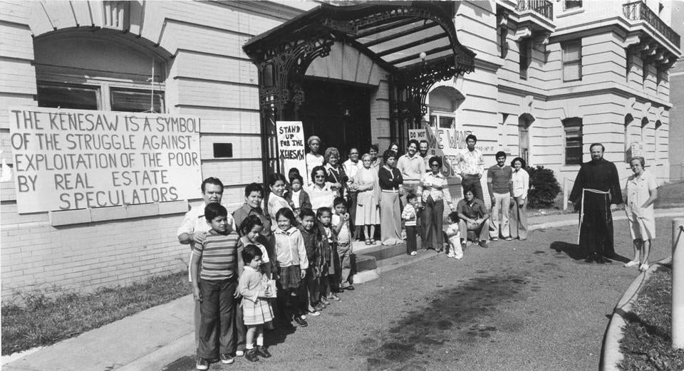 Sean O'Malley and residents of the Kenesaw gathered outside the building in 1978 to celebrate winning their struggle to buy their building and keep it out of developers' hands.