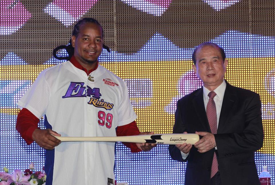 Manny Ramirez was all smiles as he was introduced in Taiwan. The former Sox slugger will play March-November for $25,000 a month.