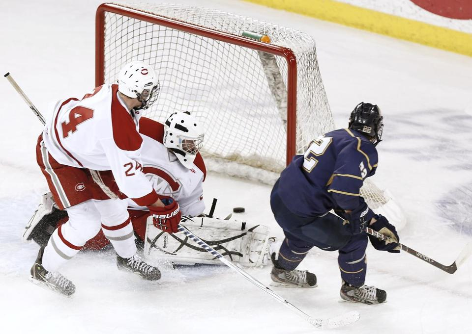 Malden Catholic's Ara Nazarian slips a shorthanded goal past Catholic Memorial's Brendan Collet.