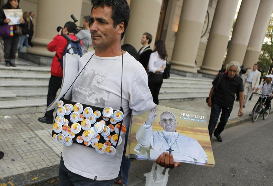 A vendor sold posters and buttons featuring the image of Pope Francis in Buenos Aires on Thursday.