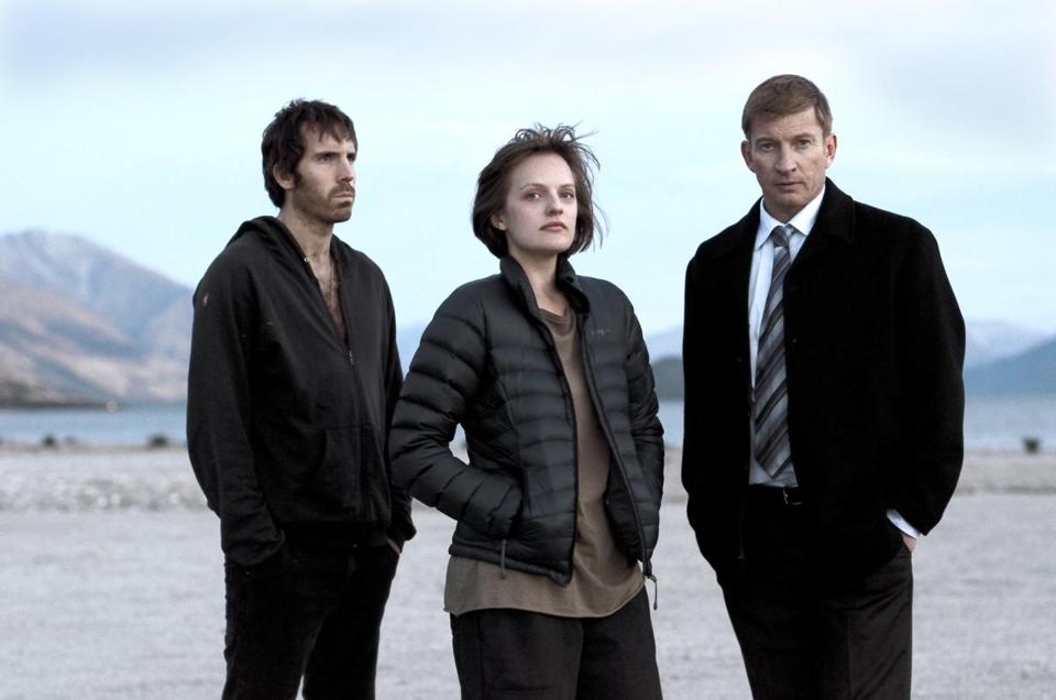 "Elisabeth Moss (center) stars in the seven-part ""Top of the Lake."""